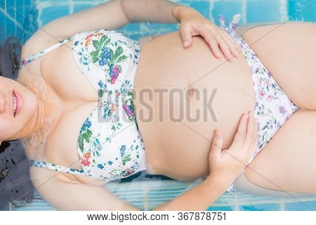 Asian Pregnant Woman. Mom And Newborn Baby. Mother Day And International Women Day. Relax And Recrea
