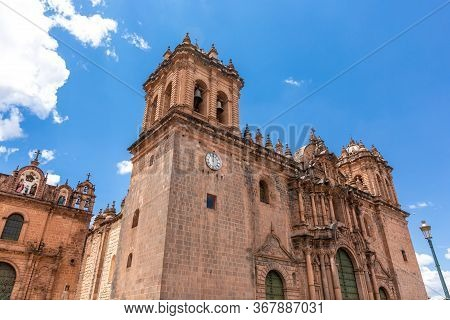 Cuzco In Peru, Panoramic View Of The Main Square An The Cathedral Church.