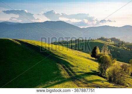 Path Through Countryside Fields. Beautiful View Of Rural Landscape At Sunset. Hills Rolling Down In
