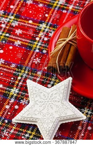 Photo Of Red Cup Of Coffee, Cinnamon And Placemats. Near Diary Red Cup Christmas White Star.  Winter