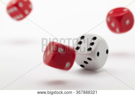 Playing Dice At White Wooden Background. Playing A Game With Dice. Rolling The Dice Concept For Busi