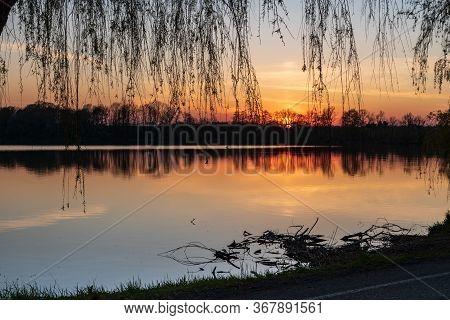 Colorful Sunset In Chko Poodri Near Jistebnik Village In Czech Republic With Bezruc Pond, Trees And