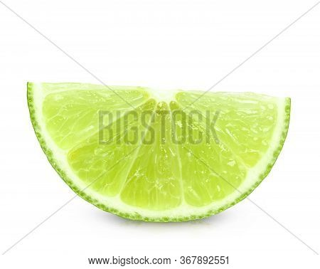Ripe Slice Of Green Lime Citrus Fruit Stand Isolated On White Background. Lime Wedge With Clipping P