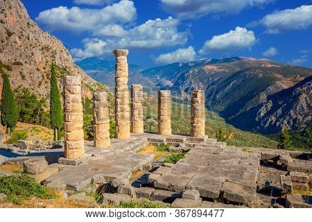 Famous Greek Ancient Ruins - The Temple of Apollo in Delphi, Greece in a summer day, European travel