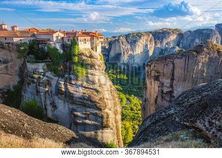 Meteora monasteries. Panoramic view on the Holy Monastery of Varlaam placed on the edge of high rock. The Meteora area is on UNESCO World Heritage. Greece, Europe