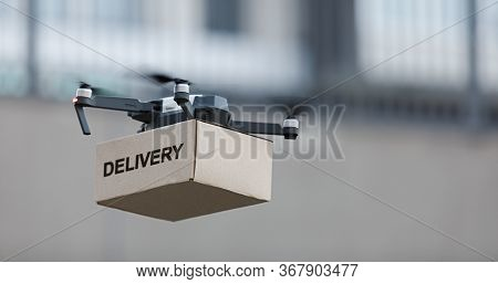 Fast And Safe Delivery, Remote Control Quadrocopter Carrying Delivery Parcel In The Air, Panorama, C