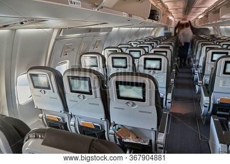 Airplane cabin interrior unboarding after arrival