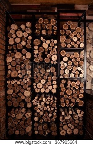 Firewood Wall. Fuel For Stove Heating. Wooden Firewood Stacked Wall. Natural Wood Background.