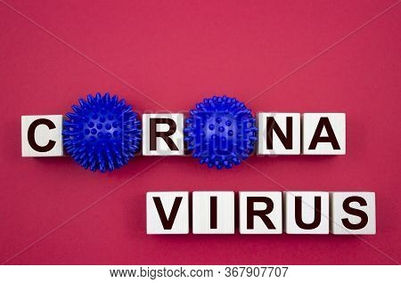 Corona Virus, Inscription On Wooden Cubes With A Model Of The Virus On A Red Background. Like The Me