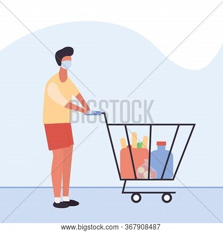 A Man With A Shopping Cart Is Standing In A Supermarket. The Cart Contains Food, Food And Drinks. A