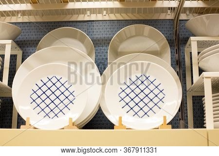 A Large Set Of Multi-colored Dishes On The Shelves Of The Supermarket. Group Of Stylish New Dishes C