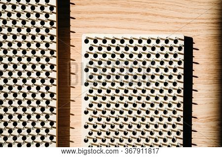 Wooden Board With Nails For Practicing Yoga. Concept Of Healthy Stimulation Of Blood Flow In The Leg