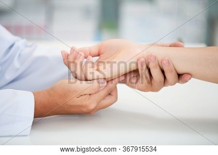 Asian Doctor Examining Patient With Wrist Bone Problems Painful Wrist Caused By Prolonged Work On Th