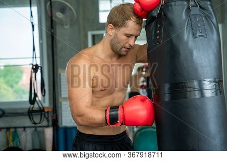 Latin Boxers Doing Some Training On A Punching Bag At A Boxing Studio,attractive Boxer Training.