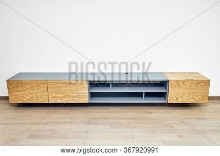 Floating Media Cabinet In Contemporary Living Room. Wall Mounted Wooden Cabinet