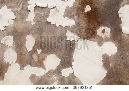 Detail Of An Old Fiberboard Wall Surface With White Paint That Has Mostly Flaked Away; Useful For Ba