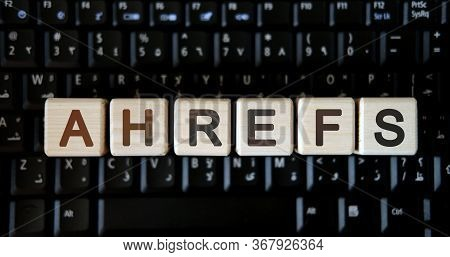 Ahrefs - Concept Text On Wooden Cubes On Background Black Keyboard
