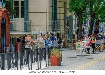 Thessaloniki, Greece - May 25 2020: Bars Open For The First Day For The Summer. Crowd Sitting On Bar