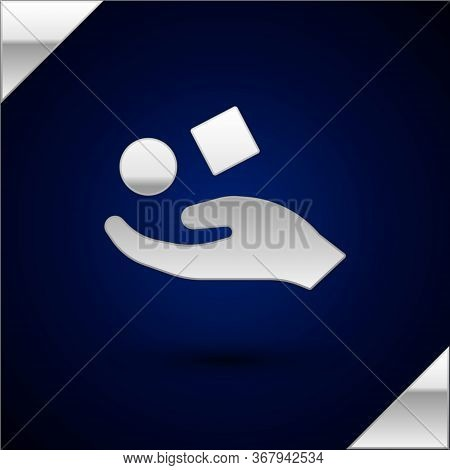 Silver Cube Levitating Above Hand Icon Isolated On Dark Blue Background. Levitation Symbol. Vector I