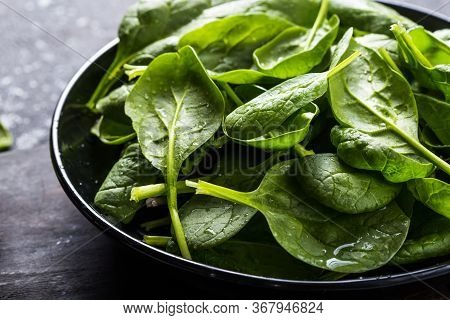 Fresh Baby Spinach On A Plate. Juicy Spinach Leaves. Diet Concept. Vegan Food. Spinach Green Fresh L