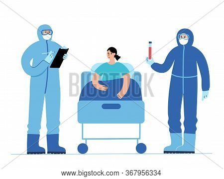 Doctor Virologist, Epidemiologist In Protective Suits Take Care About Woman Patient In The Ward In B