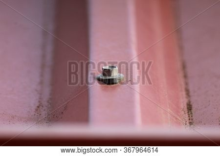 Metal Arbor Bolt Inserted Through The Metal Sheet, Bolt With A Washer Permanently Attached And Rever