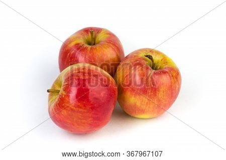A Juicy Red Apples On A White Background.