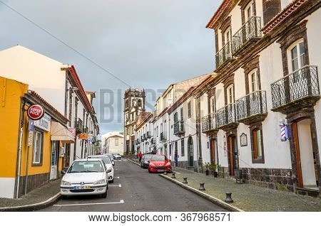Lagoa, Azores, Portugal - Jan 13, 2020: City Street In The Fishermans Village Lagoa. Parked Cars On