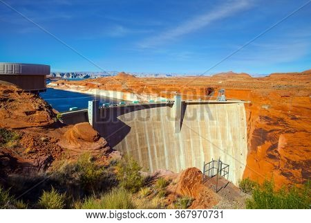 Glen Canyon Dam across the Colorado River. The great creation of mankind is a dam across the Colorado River. The best journey in life. The concept of active, environmental and photo tourism