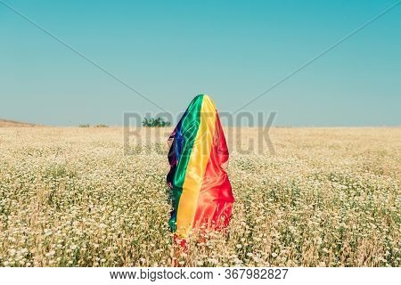 Woman Covered With Lgbt Flag On Field