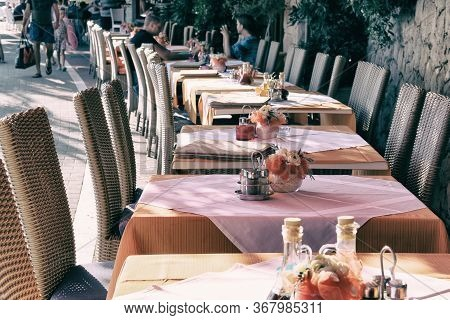 Table Setting In Modern Restaurant. Decorated Holiday Table On Outdoor Terrace Of Cafe. Patio In Cit