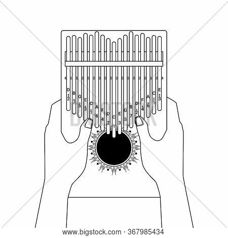 Kalimba A 17 Key Thumb Piano. Hands Holding And Play African Musical Instrument. Finger Pocket Porta