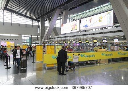 Manila, Philippines - December 8, 2017: People Wait At Ninoy Aquino International Airport In Manila,