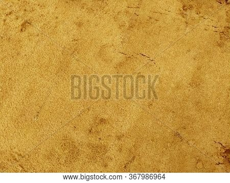 Yellow Sand Is Wet. Dry Soil Texture And Background. Background Of Red Soil. Abstract Land. Natural