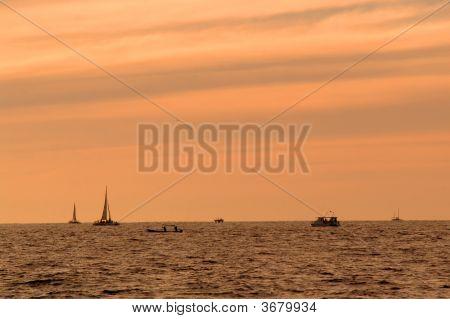 Boats On Horizon At Sundown - Los Cabos, Mexico