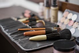 Set Of Cosmetic Brushes In A Black Leather Case.