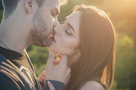 Couple Kissing. Touching Face Ecstasy And Pleasure. Making Kiss To Young Lover. Sensual Couple Make