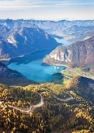Scenic view of Austrian Alps and Hallstattersee lake from the Krippenstein of the Dachstein Mountains range in Obertraun, Austria.