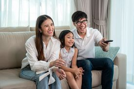 Candid Of Happy Asian Family With Father, Mother And Daughter Enjoy Weekend Activity Spending More T