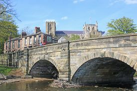 Bridge Over River Skell And Ripon Cathedral And Town, Yorkshire