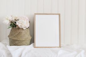 Beige Blank Wooden Picture Frame Mockup. Artistic Table Still Life Composition With Pink Peony Flowe