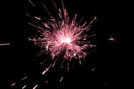 Red Sparkler Countdown On Fire With Spread Of Glitter Sparks. Luxury Entertainment At E.g. New Years
