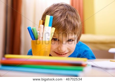 Close-up of schoolboy looking at camera with smile