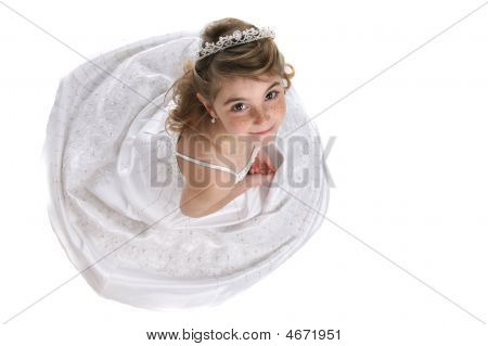 Cute Girl In Tiara And White Formal Gown As Seen From Above