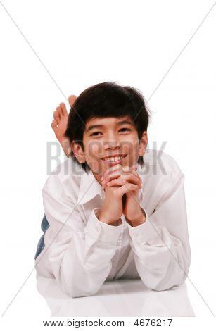Handsome Young Teen Boy Lying On Floor