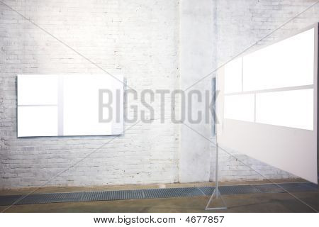 Two empty white large banners on exposition poster