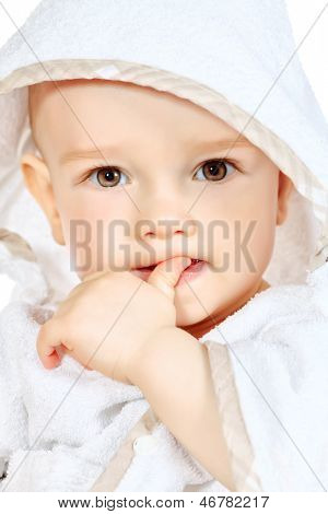Portrait of beautiful baby in white towel. Isolated over white.