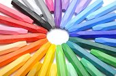 Row of colorful crayon making circle shape over white background poster