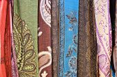 Selection of wonderfully bright colourful cloth at a market stall in Marrakesh poster