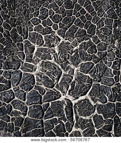 Black pitch, tar background.